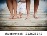 Closeup Of Feet Of Family With...