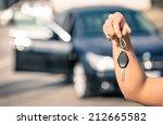 man's hand holding modern car...   Shutterstock . vector #212665582