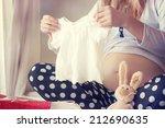Pregnant Woman Holding A  Bab...