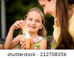 mother with her daughter... | Shutterstock . vector #212708356