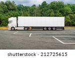 big white truck on parking | Shutterstock . vector #212725615