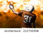 football player on a orange... | Shutterstock . vector #212733508