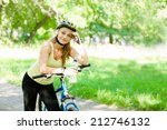 young woman with mountain bike...   Shutterstock . vector #212746132