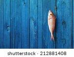 Fresh Raw Fish Hanging On A...