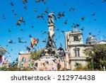 pigeons flying around plaza... | Shutterstock . vector #212974438