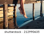 woman legs as she sitting on... | Shutterstock . vector #212990635