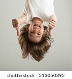 little boy hanging upside down | Shutterstock . vector #213050392