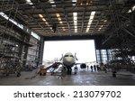 inside aerospace hangar | Shutterstock . vector #213079702