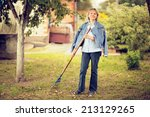 Mature woman raking autumn...