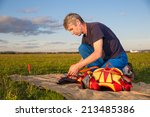Man Straighten  Parachute ...