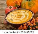 Pumpkin Soup On Brown Background