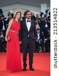 Small photo of VENICE - AUGUST 27, 2014: Director Alejandro Gonzalez Inarritu and his wife Maria Eladia Hagerman attends the Opening Ceremony and 'Birdman' premiere during the 71st Venice Film Festival at Palazzo Del Cinema on 27.08.14