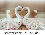 towel swans shaped on the bed... | Shutterstock . vector #213531058