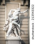 Small photo of VIENNA, AUSTRIA - AUGUST 4, 2013: Statue of Hercules fighting Antaeus at Hofburg palace entrance, Vienna, Austria