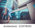 beautiful woman is walking in...   Shutterstock . vector #213578392