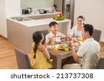 asian family dining together in ... | Shutterstock . vector #213737308