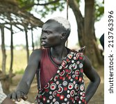 Small photo of MANGALLA, SOUTH SUDAN-JUNE 22 2012: Unidentified Dinka woman with tribal scarification in South Sudan