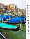 Gondolas anchored on Grand Canal, Venice Italy - stock photo