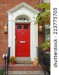 Red Main Door In Autumn