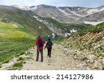 couple of travelers walking on... | Shutterstock . vector #214127986