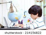 schoolboy at a desk working on... | Shutterstock . vector #214156822