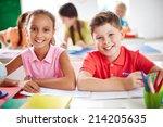 schoolboy and schoolgirl... | Shutterstock . vector #214205635