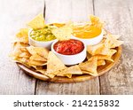 Nachos With Various Sauces On...
