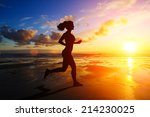 Girl Running At Sunset With...