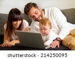 young family on laptop | Shutterstock . vector #214250095