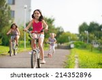 three happy children riding on... | Shutterstock . vector #214352896