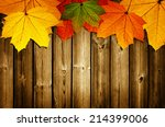 Wooden Background With Autumn...