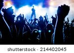 silhouettes of concert crowd in ... | Shutterstock . vector #214402045