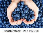 female hands holding tasty ripe ... | Shutterstock . vector #214442218