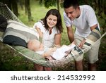 Happy Young Family Spending...