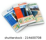 Travel Guide Books On White...