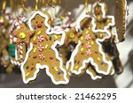 Christmas tree decorations in a form of a funny gingerbread man - stock photo