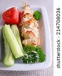 Small photo of A La carte grilled chicken on wooden skewers