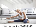 young woman at home stretching... | Shutterstock . vector #214731148
