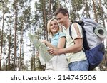 happy young backpackers reading ... | Shutterstock . vector #214745506
