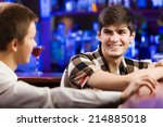 two young men sitting at bar... | Shutterstock . vector #214885018