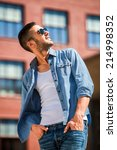 handsome young man in bluejeans ... | Shutterstock . vector #214998352