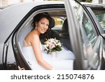 young bride in a wedding car....