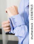 man fastening cufflinks mid... | Shutterstock . vector #215087815