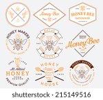 honey and bees vector badges... | Shutterstock .eps vector #215149516