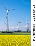 wind wheels and yellow rapeseed | Shutterstock . vector #215183425