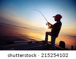 young man fishing from the boat ... | Shutterstock . vector #215254102