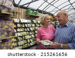 Senior Couple Shopping In...