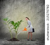 businesswoman with can watering ... | Shutterstock . vector #215270782