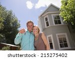 couple standing in driveway in... | Shutterstock . vector #215275402