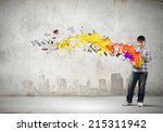 young boy splashing colorful... | Shutterstock . vector #215311942